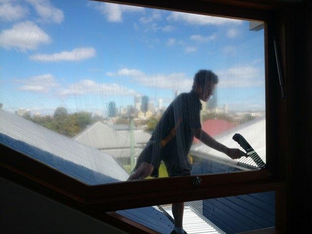 Washing a window with brisbane view